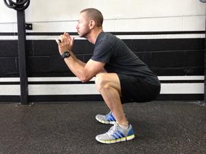 Parmi les exercices pour perdre du ventre, l'air squat est l'un des plus efficaces